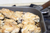 Juicy chicken meat in a frying pan — Stock Photo