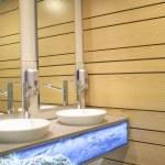 Interior washbasin and wooden wall of a bathroom — Stock Photo