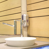 Interior washbasin and wooden wall of a bathroom — Stock Photo