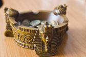 Ashtray with money — Stock fotografie
