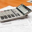 Stock Photo: Calculator on documents