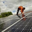 Electrician checking solar panels — Foto de Stock