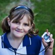 Happy young girl with stop watch at school sports day — Stock Photo
