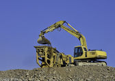 Earth moving equipment in operation — Stock Photo