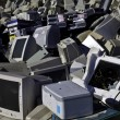 Computers and monitors piled up for recycling - Stock Photo