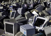 Computers and monitors piled up for recycling — Stock Photo