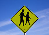 Road sign warns motorists of crossing — Stock Photo