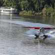 Stock Photo: Description: Float plane landing on ChenRiver
