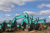 Green earthmoving machines ready for action — Stock Photo