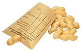 Wage Packet And Peanuts — Stock Photo