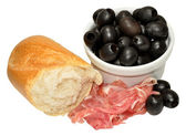 Parma Ham And Black Olives — Stock Photo