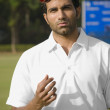 Stock Photo: Bowler tossing cricket ball in air