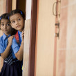 School girls peeping from a classroom — Foto Stock