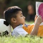 Boy lying and reading — Stock Photo #39443573