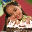 Girl with birthday cake — Stock Photo