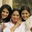 Stock Photo: Mother and daughters celebrating Holi