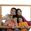 Family with frame — Stock Photo