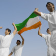 Stock Photo: Players holding national flag