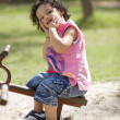 Boy sitting on a see-saw — Stock Photo #39448873