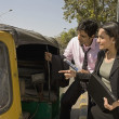 Stock Photo: Hiring an auto rickshaw