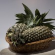 Постер, плакат: Pineapples in a basket