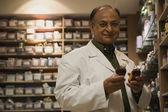 Doctor in drug storeroom — Stock Photo