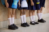 School children standing in a row — Stock Photo