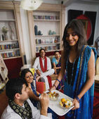 Friends eating sweets during Diwali — Stock Photo