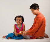 Boy and girl holding diya — Stock Photo