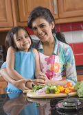 Mother and daughter cooking — Stock Photo