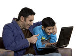 Father and son with a laptop — Stock Photo