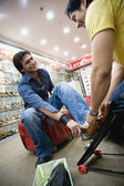 Man selecting shoes — Stock Photo