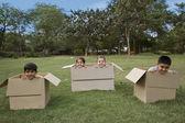 Children inside boxes — Stock Photo