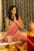 Woman performing pooja — Stock Photo