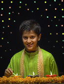 Boy lighting Diya — Stock Photo