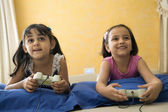 Little girls playing video game — Stock Photo