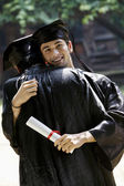 College graduates hugging — Stock Photo