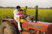 Family on tractor — Stock Photo