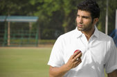 Player holding cricket ball — Stock Photo