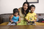 Children playing video games — Stock Photo