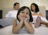 Family on the bed — Stock Photo