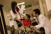 Doctors with boy — Stock Photo