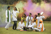 Family celebrating Holi — Stock Photo