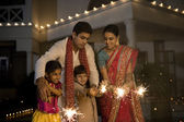 Family playing with firecrackers — Stock Photo