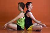 Men doing yoga — Stock Photo