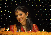 Woman lighting Diya — Fotografia Stock