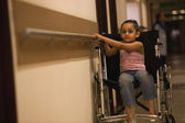 Girl on wheelchair — Stock Photo