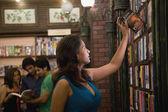 Woman selecting a book — Stock Photo