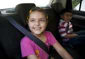 Children sitting inside a car — Stock Photo