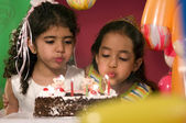 Girls with birthday cake — Stockfoto